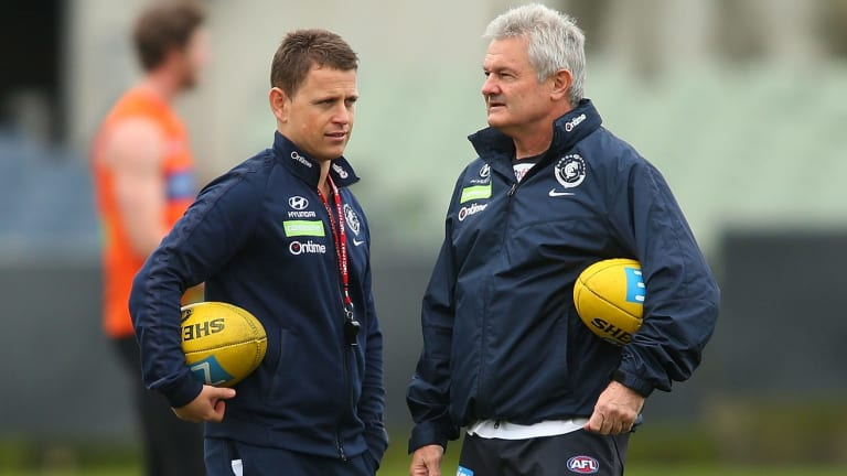 Carlton coach Brendon Bolton speaks with assistant coach Neil Craig during a Blues training session at Ikon Park.