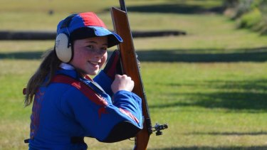 New England Girls' School team member Ella (from Moree) finishing her target rifle shooting stage at Hornsby Range.