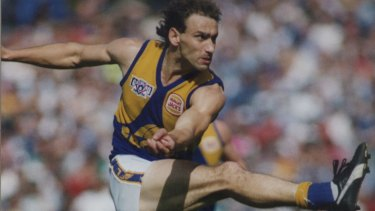 Peter Matera kicks the ball in the 1992 Grand Final, the first to be won by a non-Victorian team. Matera was awarded the Norm Smith Medal.