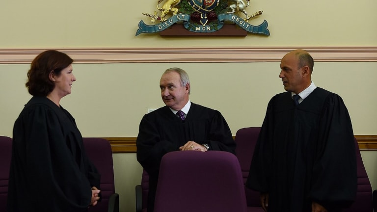 NSW Chief Magistrate Graeme Henson (centre) with magistrates Julie Soars (left) and Imad Abdul-Karim (right) at the Downing Centre, the setting for documentary series <i>Court Justice: Sydney</i>.