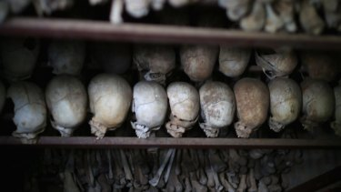 In 2014, metal racks hold the bones of thousands of genocide victims inside one of the crypts at the Nyamata Catholic Church memorial.
