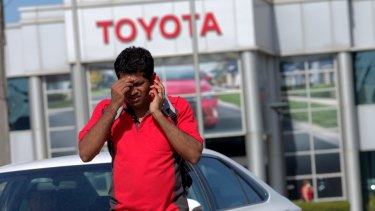 A Toyota worker shares the news on Tuesday afternoon.