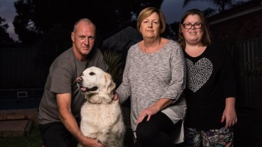 Ken and Diane Barrow, with their daughter Lauren and labrador Mia, hope the royal commission will bring some accountability.