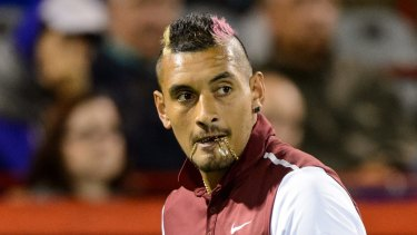 Nasty personal sledge ... Nick Kyrgios bites onto his chain during his match against Stan Wawrinka in Montreal.