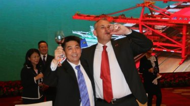 Adam Giles, the former chief minister of the Northern Territory, toasts Ye Cheng, chairman of Shandong Landbridge Group, after the 99-year lease of the Port of Darwin was signed.