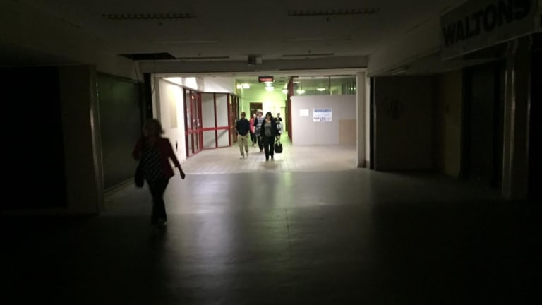 Commuters walking through the dark into Fortitude Valley train station on Tuesday.