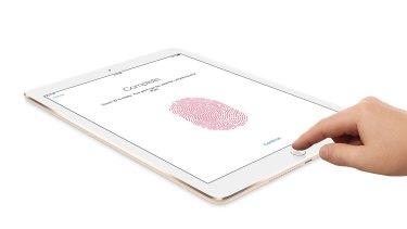 Apple's Touch ID technology uses a fingerprint identity sensor to unlock the iPad Air 2.