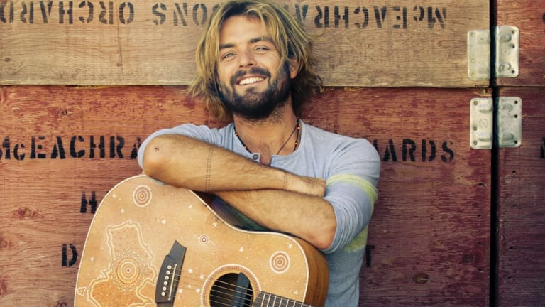 Celebrated vegetarian Xavier Rudd is under fire over his hit song appearing in a KFC ad.