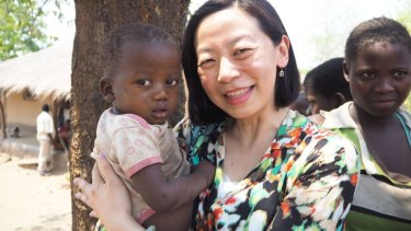 Ailan Tran with baby Mary in Malawi.