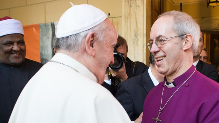 Interfaith encounter: Pope Francis, left, greets Justin Welby, Archbishop of Canterbury.