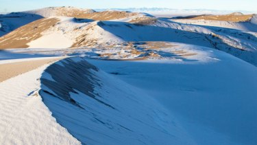 Sand dunes in the Sahara covered in snow.