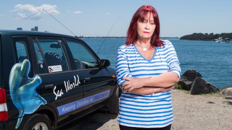 "Animal rights activist June Killington visits Sea World to distribute postcards that claim the park is an ""aquaprison""."
