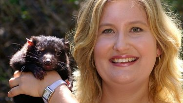 Geneticist Kathy Belov with a devil pup.