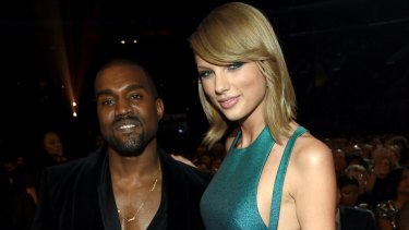 Kanye West and Taylor Swift in happier times at the 2015 Grammys.