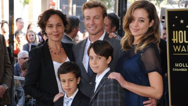 Simon Baker and wife Rebecca Rigg with daughter Stella and sons Harry, at left, and Claude, in Hollywood in 2013.