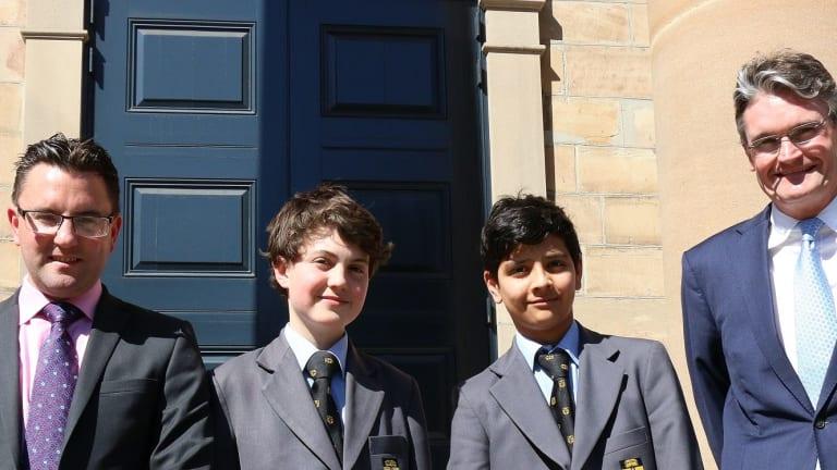 From left: Sydney Grammar School headmaster Dr Richard Malpass with  scholarship students Jack Glass, Nayan Gallego Sivaraman and master of the lower school Mr Rollo Hesketh.