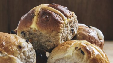 Hot cross buns have appeared in some Woolworths stores the day after Christmas.
