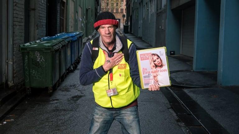 A vendor of <i>The Big Issue</i>.