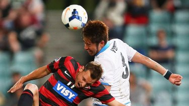New addition: Yusuke Tanaka of Kawasaki Frontale challenges Wanderers opponent Brendon Santalab during the AFC Asian Champions League match at Pirtek Stadium last March.
