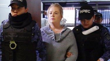 Cassandra Sainsbury arrives for a court hearing in Bogota.