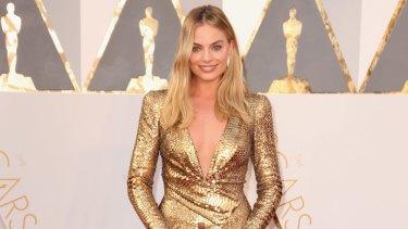 Golden girl Margot Robbie attends the 2016 Academy Awards.