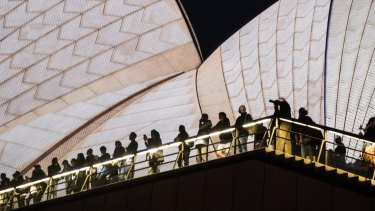 People wait for the start of Vivid on the Opera House in 2017.