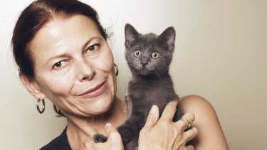 Kristina Vesk, CEO of the Cat Protection Society of NSW, with a domestic shorthair kitten.