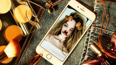 "Vali Clarke and her selfie using Snapchat's dog-face filter: ""(teenage girls') social media doesn't necessarily represent the way they actually are."""