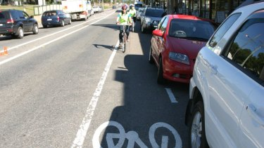 The cyclists are believed to be protesting against unseparated bike paths, such as this one, which are between parked cars and the main road.