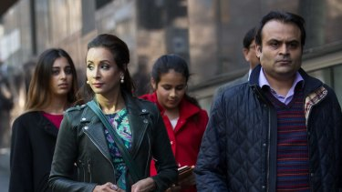 Radhika and Pankaj Oswal and their children leaving court last month.