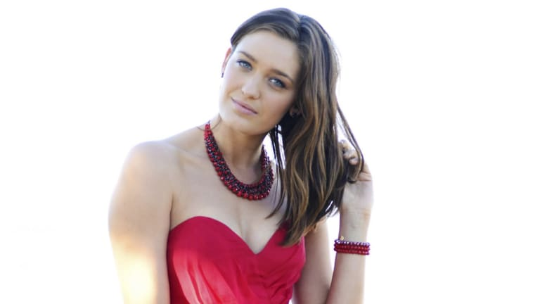 City girl: Tess Haubrich rejoins the Home and Away cast as  John Palmer's ''rude'' daughter Shandi.