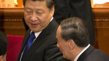 Chinese President Xi Jinping, left, with Politburo Standing Committee member Wang Qishan.