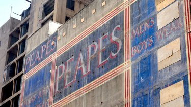 A ghost sign on George Street after the demolition of buildings on the old Menzies Hotel site.