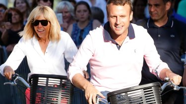 French President Emmanuel Macron and his wife Brigitte Trogneux leave their house  in Le Touquet-Paris-Plage on the eve of the second round of the French parliamentary elections.