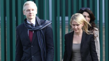 Jennifer Robinson, centre, with her client Julian Assange and friend Amal Clooney.