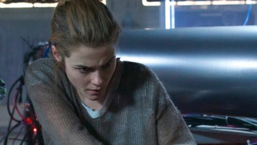 Rachael Taylor helps propel the action with a suitably taut performance in ARQ.