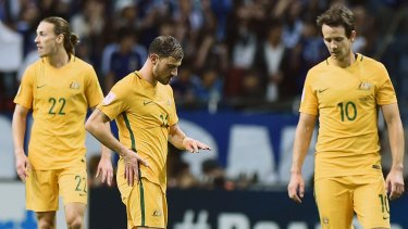 Lacklustre: It was a disappointing night for the Socceroos in Tokyo.