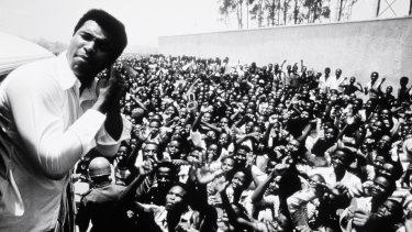 "Muhammad Ali with fans in Zaire, the location in 1974 for the ""Rumble in the Jungle"" fight that pitted Ali against George Foreman, the then world heavyweight champion. Ali won."