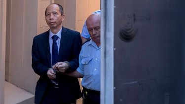 Robert Xie is led away after he was sentenced this week.