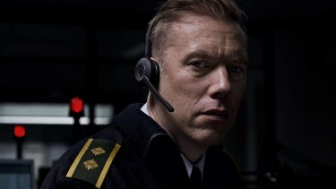 Police dispatcher Asger Holm (Jakob Cedergren) handles calls during a night shift in <i>The Guilty</i>.