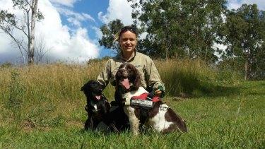Olivia Woosnam with Taz, a koala protection dog, and Shaggy.