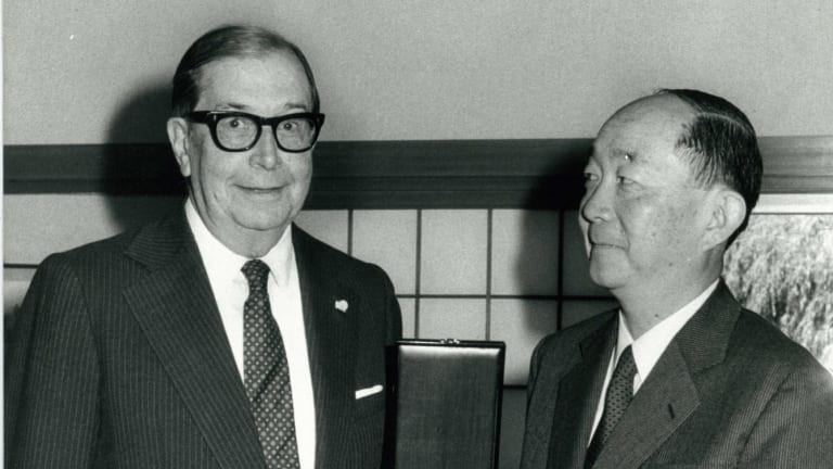 Former CSR chairman managing director Sir James Vernon (left) in 1983, receiving an honour from the Japanese ambassador.