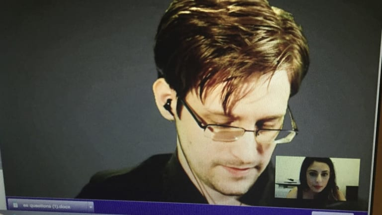 Screenshot of the encrypted video interview with Edward Snowden. Think Inc co-founder Suzi Jamil (bottom right) was the intermediary putting Fairfax Media's questions to the US whistleblower who is holed up in Russia.