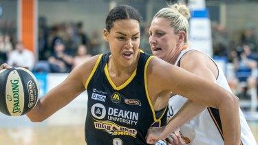 Liz Cambage makes a path to the basket against Suzi Batkovic.