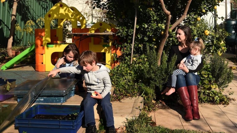 Elizabeth Slakey with her children (from left) Luca, 8, Declan, 5, and Pippi, 2: Valuations for the family's Haberfield home differ by nearly $350,000.