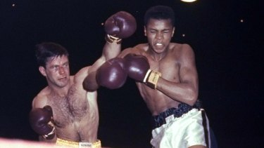 """""""Hard as nails"""": Tony Madigan fighting Cassius Clay, later Muhammad Ali, in 1959."""