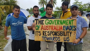 Men protest their treatment at the Manus Island processing centre.