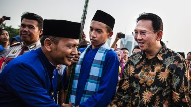 Ahok, right, in 2014. A Christian and ethnic Chinese, he became governor after his predecessor and political ally Joko Widodo was elected President of Indonesia.