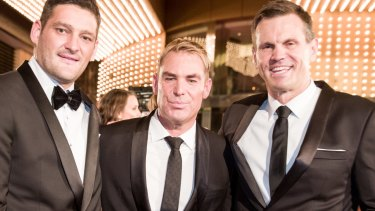 Shane Warne, flanked by Brendan Fevola and Paul Harragon, looks uncomfortable posing for a Fairfax Media photograph at the Logie Awards.
