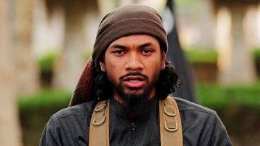 Neil Prakash, aka Abu Khalid al-Cambodi, in a still from an IS propaganda video.